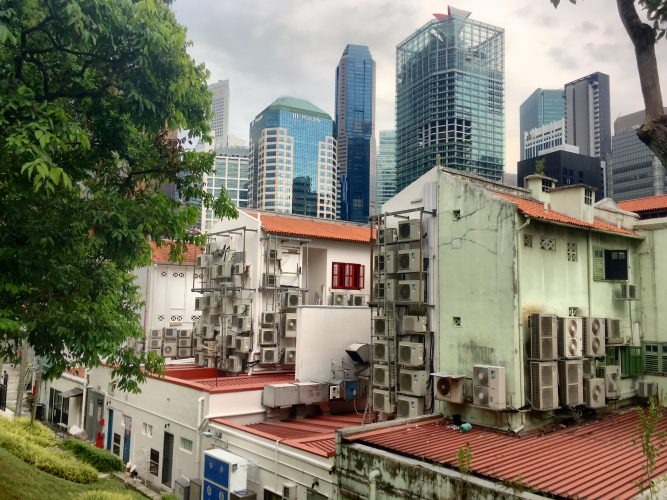 Air conditioning is a big topic in tropical Singapore. Paradoxically, while keeping houses cool, they increase the heat outside even more, leading to the so-called urban heat island effect.