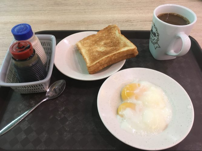 """The typical Singaporean """"breakfast set"""": 2 half-boiled eggs which are mixed with soy sauce and pepper and eaten with kaya toast (a coconut jam), alongside super-sweet coffee."""