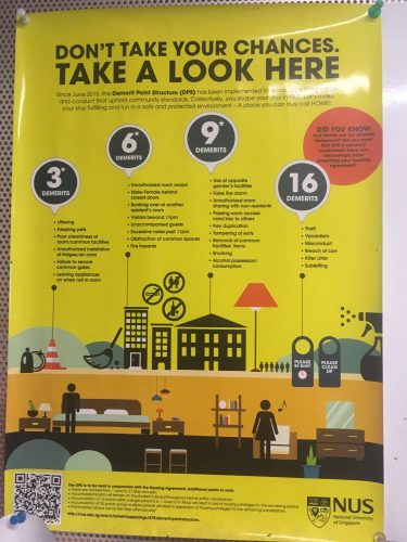 A poster from the university residence. If you misbehave (e.g. male and female behind closed doors), you get demerit-points, and if you collect too many of these points, you get punished. Reminds a bit of the social credit-system in China.