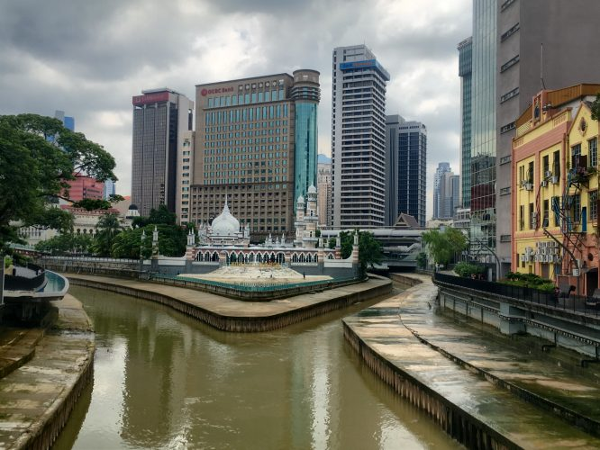 """Next stop: Kuala Lumpur, the capital. The name means """"muddy confluence"""", and that's what you see in this picture: the confluence of two muddy rivers. The government wants to revitalise the river by 2020. Still way to go."""