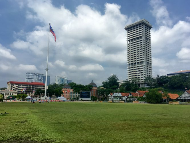 Merdaka Square, where Malaysia's independence was declared. And - the highest flagpole in the world at 95 m. The British used the grassy field to play cricket.