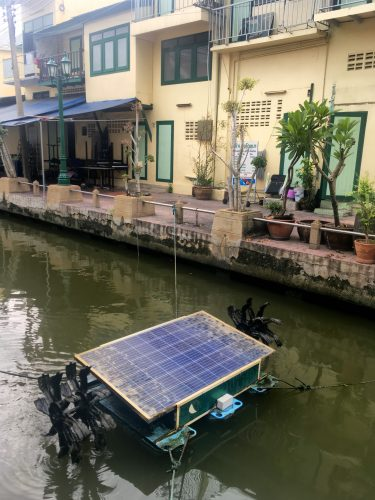 Solar-powered water wheels to aerate the canal.
