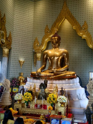 A 5.5 ton solid gold Buddha that was only discovered 40 years ago as it had been covered in plaster before to hide it from invading troops.