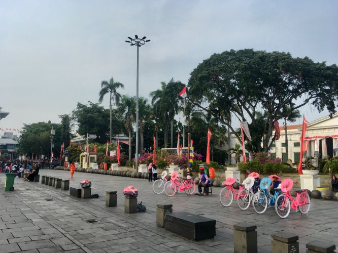 In the old town of Jakarta. It is very popular with locals to rent Dutch bikes to circle around the main square that was built by - the Dutch.