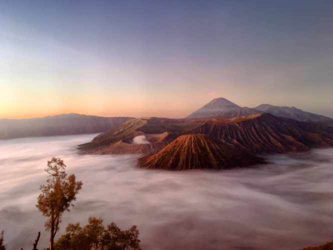 "Sunrise view on Bromo (which is the small volcano that has the ""cloud"" on top)."