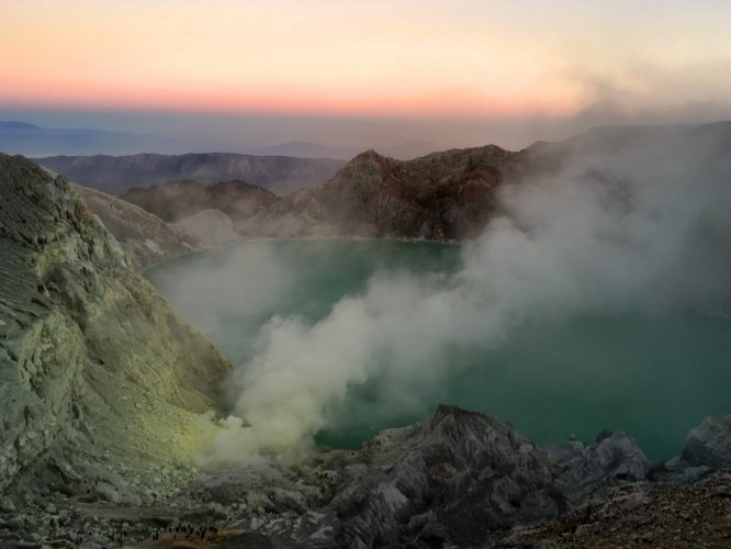 Sunrise from the top. The place where the sulphur is mined and the blue fire can be seen is where the smoke emerges at the side of the lake.