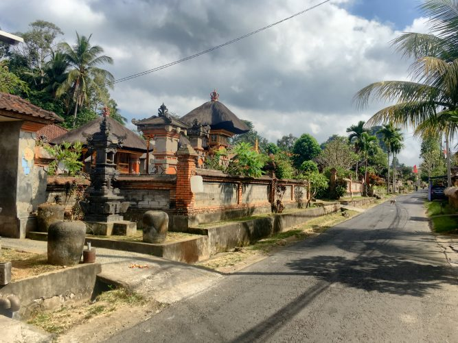 A typical street in Bali - lined with temples.