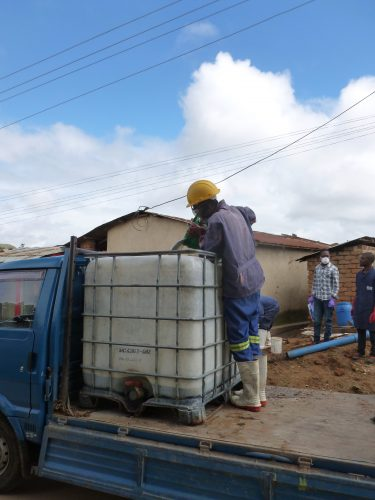 After the trash is removed, the toilet is emptied bucket for bucket and manually transferred to a 1m3-tank.