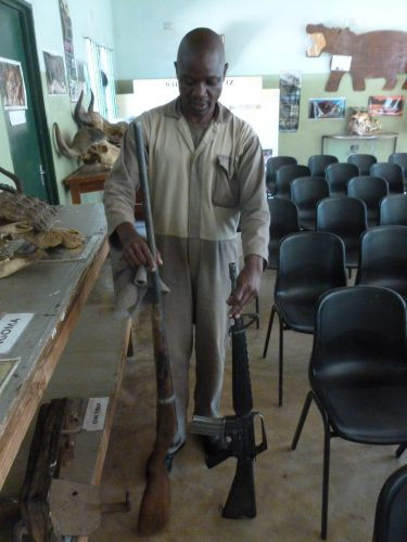 """In a conservation center, the ranger shows me the selfmade gun of a poacher (on the left) as compared to his own (""""that's the weapon the Americans used in Vietnam!!"""")."""