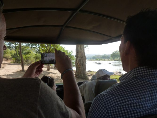Taking a picture of someone taking a picture. Besides the driver, there were 8 people on the car - all from Germany. So we did the introductory round in German. Not exactly what you would expect somewhere in the bush at the end of the world.