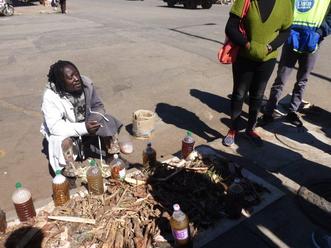 This traditional healer collects roots and other plant parts and makes remedies out of it, with which he claims to be able to heal any disease, from a broken heart to AIDS.