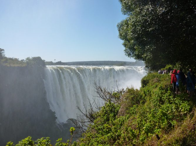 The Victoria Falls are neither the highest nor the widest waterfalls in the world, but they are the largest as they have the largest sheet of falling water (width 1708 m, height 108 m), a part of which can be seen here.